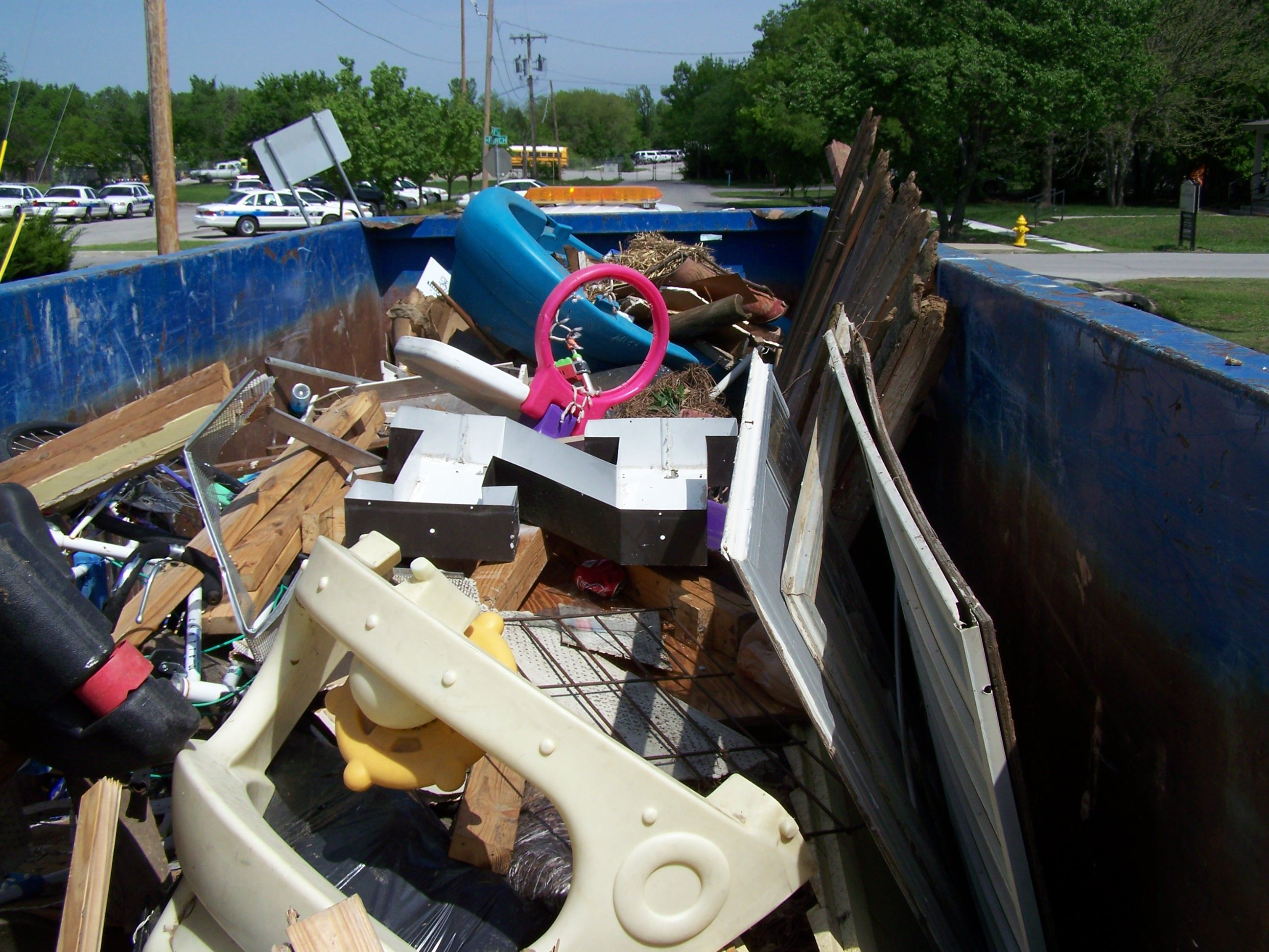 Dumpster full of debris from residents on CARES Day of Service