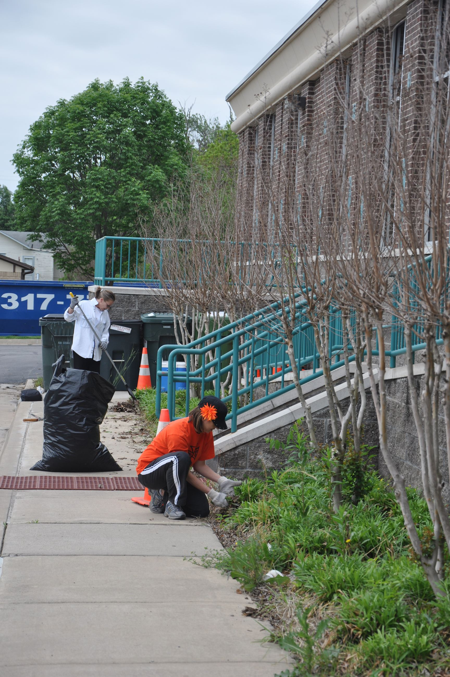 Volunteers clean out flowerbeds