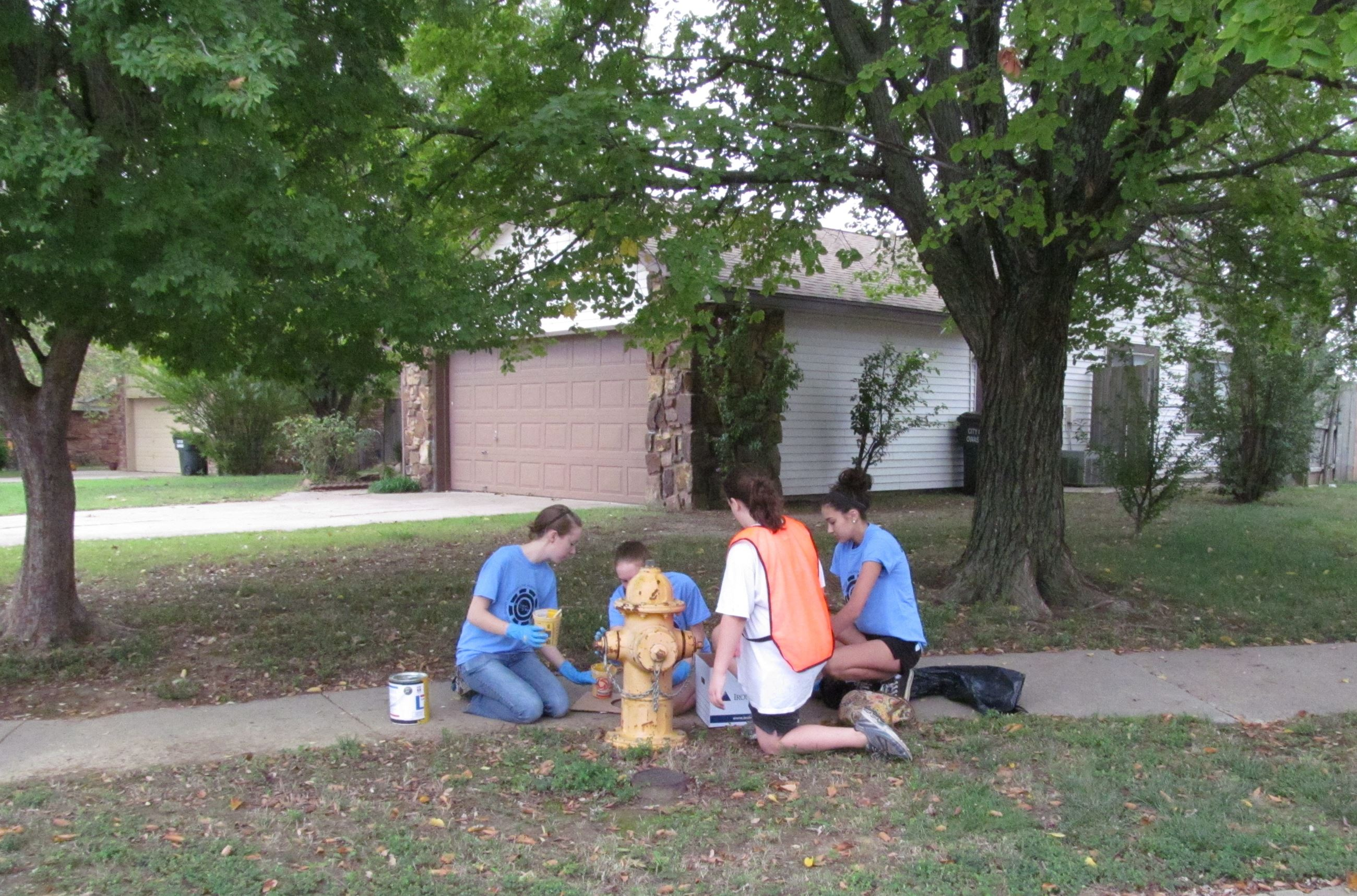 Volunteers painting fire hydrants