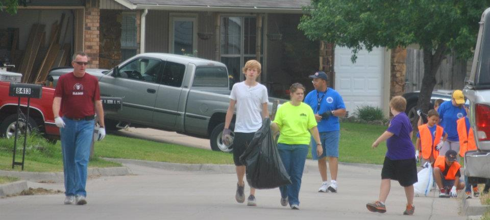 Volunteers picking up litter in neighborhood