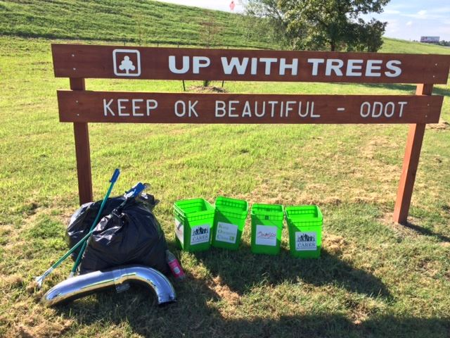 Litter bags and buckets collected below Up With Trees sign