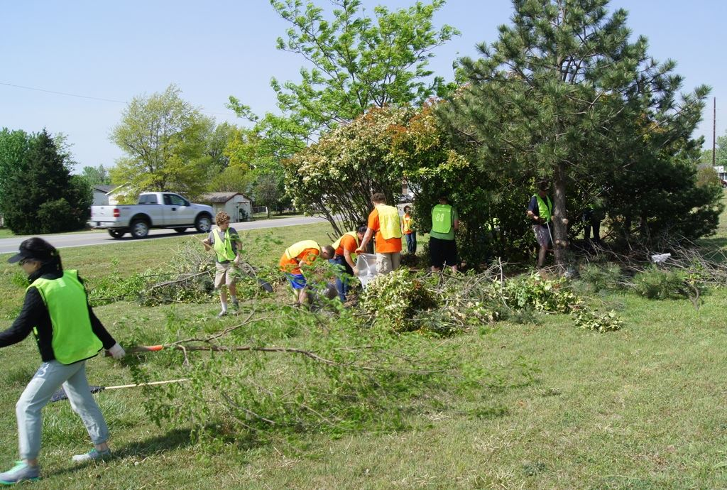 Volunteers trimming trees and shrubs